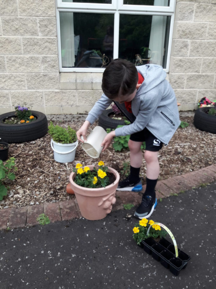 Simon Community Ensures No Child Left Behind Through New Play Learning Service Young Boy Gardening