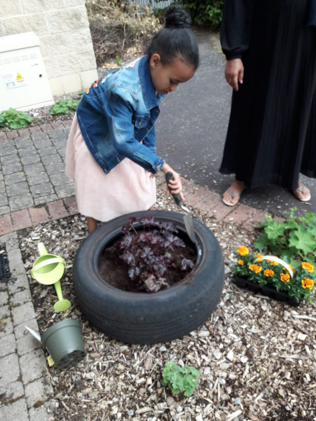 Simon Community Ensures No Child Left Behind Through New Play Learning Service Young Girl Gardening